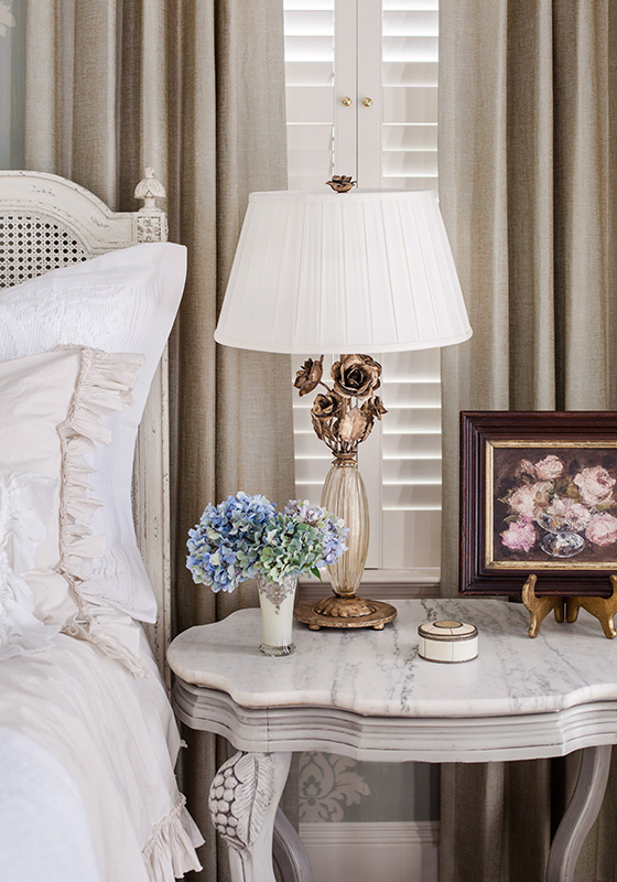 Melea Markell's Gabrielle Rose Lamp on a bedside table